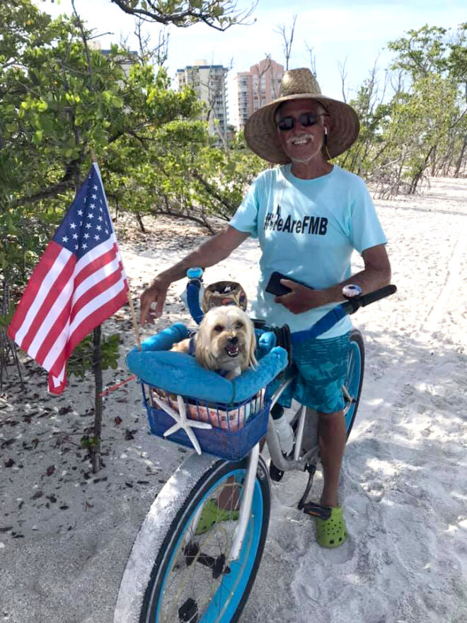 bicyclist-with-his-doggies-on-the-beavh-wearing-a-WeAreFMB-tshirt
