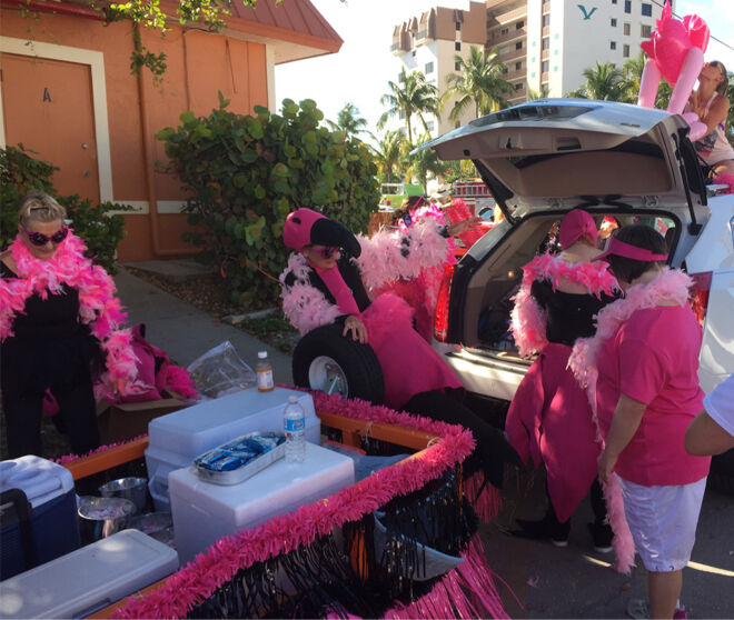 hooking up the pinkj flamingo parade float-fmb community foundation