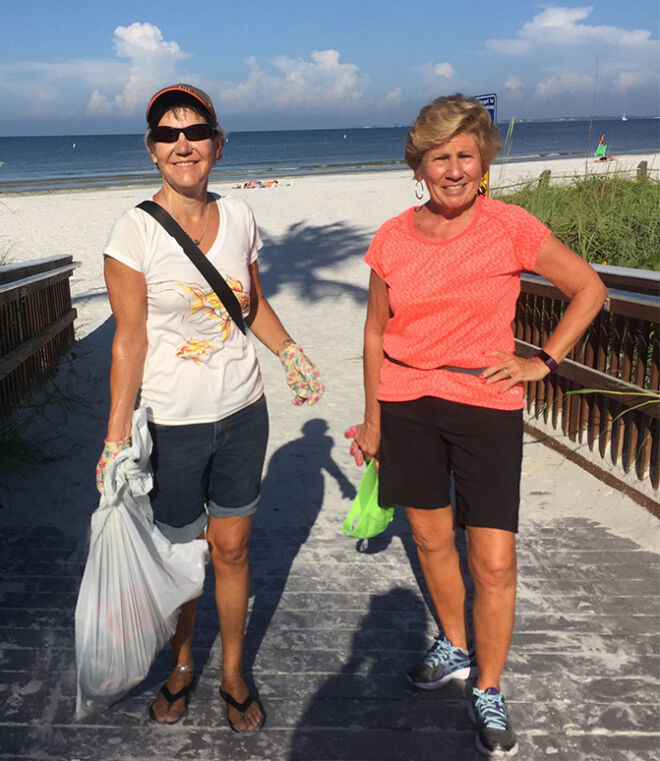 beach clean up two members of fort myers beach community foundation