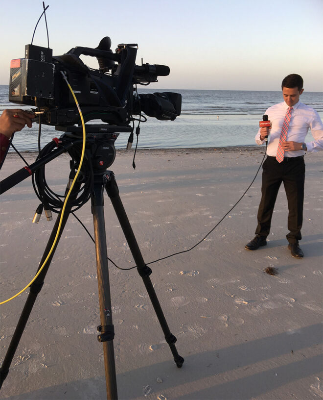 news reporter broadccasting from on fort myers beach