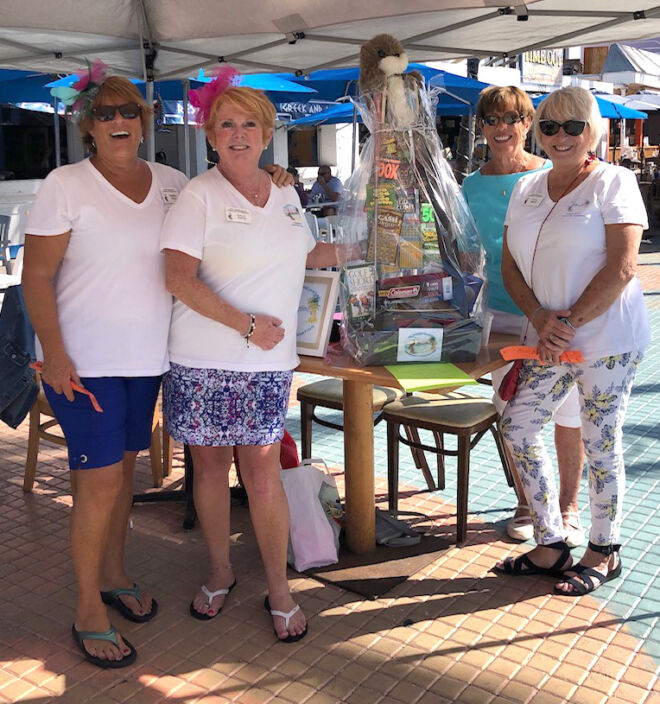 ladies-in-times-square-promoting-wearefmb-fort-myers-beach-community-foundation